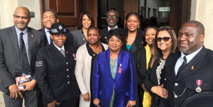 Baroness Doreen Lawrence is pictured in April 2018 outside St Martin-in-the-Fields shortly after the Prime Minister announced that 22 April would be commemorated as Stephen Lawrence day. DI Munro is directly behind her.